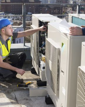 man working on air conditioner unit